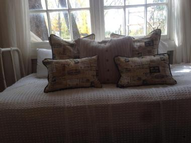 yellows, blacks and creams really add an element of interest to the pillows. an old world, vintage feel!!