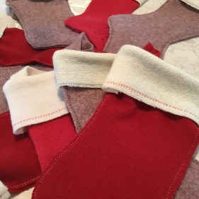 Blanket stitching in bright colours on cuffs