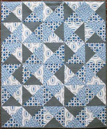Favorite Spring Quilts, featured by top US quilting blog, Seams Lie a Dream Quilt Designs: Quarter Turn crib quilt pattern by Kate Colleran