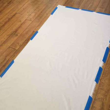 muslin taped to the floor