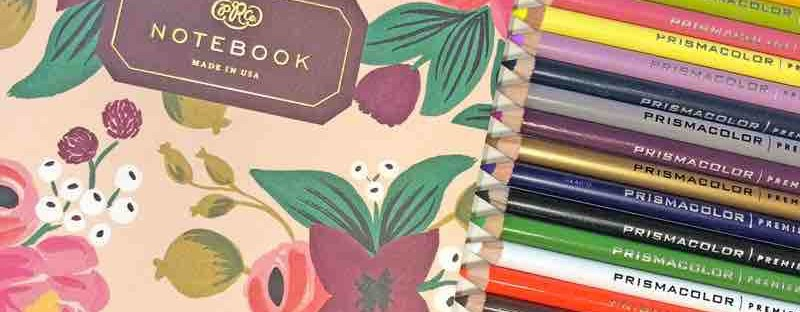 colored pencils, blank notebook