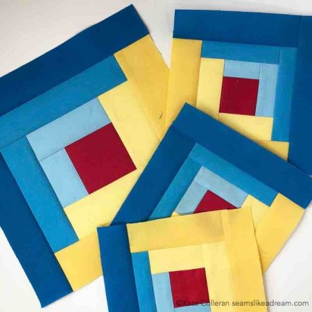 The Adventure Quilt ... a Road Trip Quilt Along Project, featured by top US quilting blog and shop, Seams Like a Dream Quilt Designs: blue and yellow Log Cabin blocks