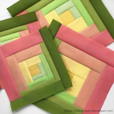The Adventure Quilt ... a Road Trip Quilt Along Project, featured by top US quilting blog and shop, Seams Like a Dream Quilt Designs: coral and green log cabin blocks