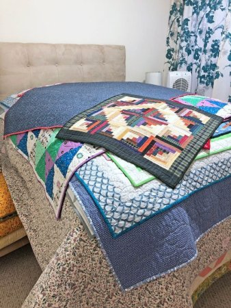 bed with quilts piled on it!