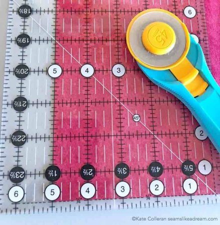 Exploring the Basics: the 6 Top Tips for Cutting Fabric featured by top US quilting blog Seams Like a Dream Quilt Designs shows how to cut more than one strip.