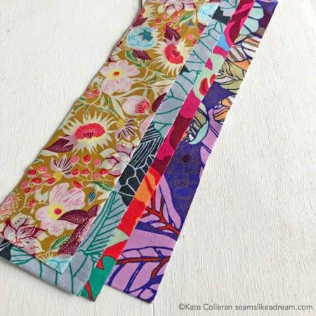 Exploring the Basics: Fabric Die Cutting featured by top US quilting blog and shop, Seams Like a Dream Quilt Designs: explains the option of die cutting fabric for your quilting strips.