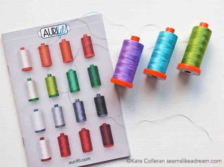 Your Guide to the Different Types of Sewing Threads featured by US top quilting and sewing blog, Seams Like a Dream Quilt Designs, explains how to pick thread for your next quilting project.