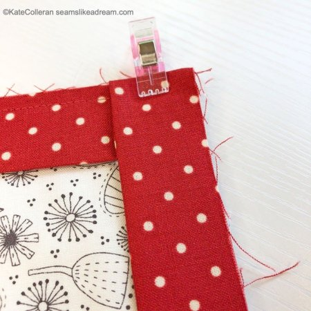 Exploring Quilting Basics: Binding a Quilt, featured by top quilting blog, Seams Like a Dream Quilt Designs, explains some best practices when binding a quilt.