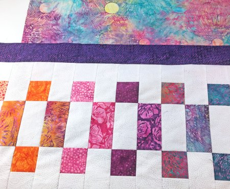 Top US quilting blog and shop, Seams Like a Dream Quilt Designs, shares tips to finish the quilt in the 2021 Lighthouse Steps Quilt Along!