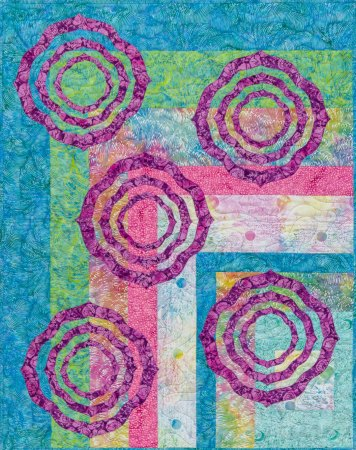Top US quilting blog and shop, Seams Like a Dream Quilt Designs, shares about a modern log cabin quilt pattern!