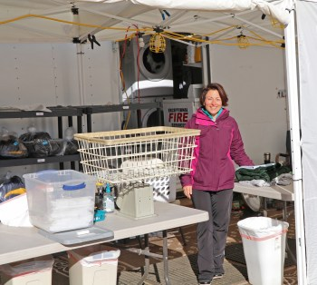 Teresa Sigmon works laundry fire support