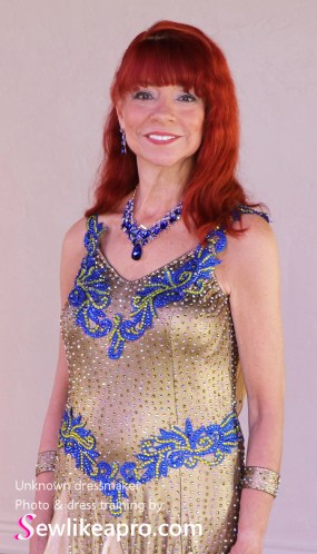 saturated blue lace on the neckline looks great on this ballroom dancer, smooth dance dress, rhinestones, Dancesport dress, ballroom dancing dress