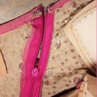 line stretch mesh with flesh color lycra so rhinestone glue sticks to fabric better, invisible zipper, bra cups