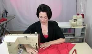 Teresa basting a lycra body suit. Sew Like A Pro™, the online sewing school for Dancesport, Country and Skate Dresses, created by Teresa Sigmon