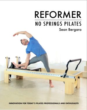 Sean Bergard stretching to the side on a reformer