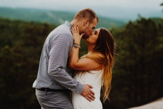 engaged couple kissing in the oregon mountains