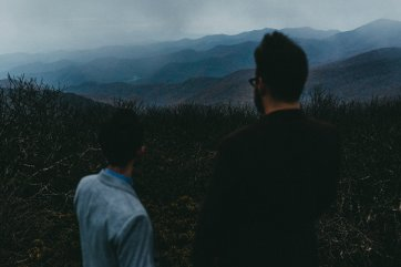 gay couple overlooks the valley Craggy Gardens during their Asheville NC engagement photos