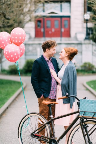 couple embraces during their fifties styled engagement shoot