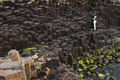 couple embraces during their giants causeway engagement photos