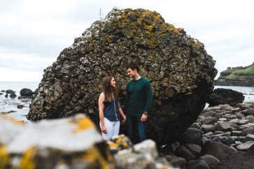 couple holds hands during their giants causeway engagement photos