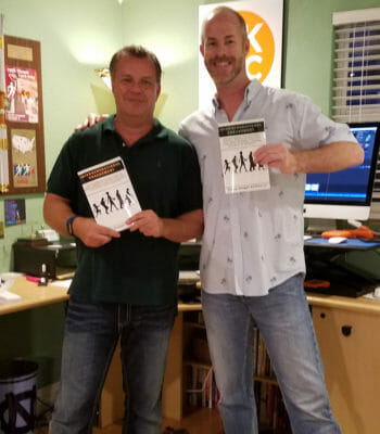 """Dillon Knight Kalkhurst and Sean Donovan pose with copies of Dillon's book """"Intergenerational Engagement"""""""