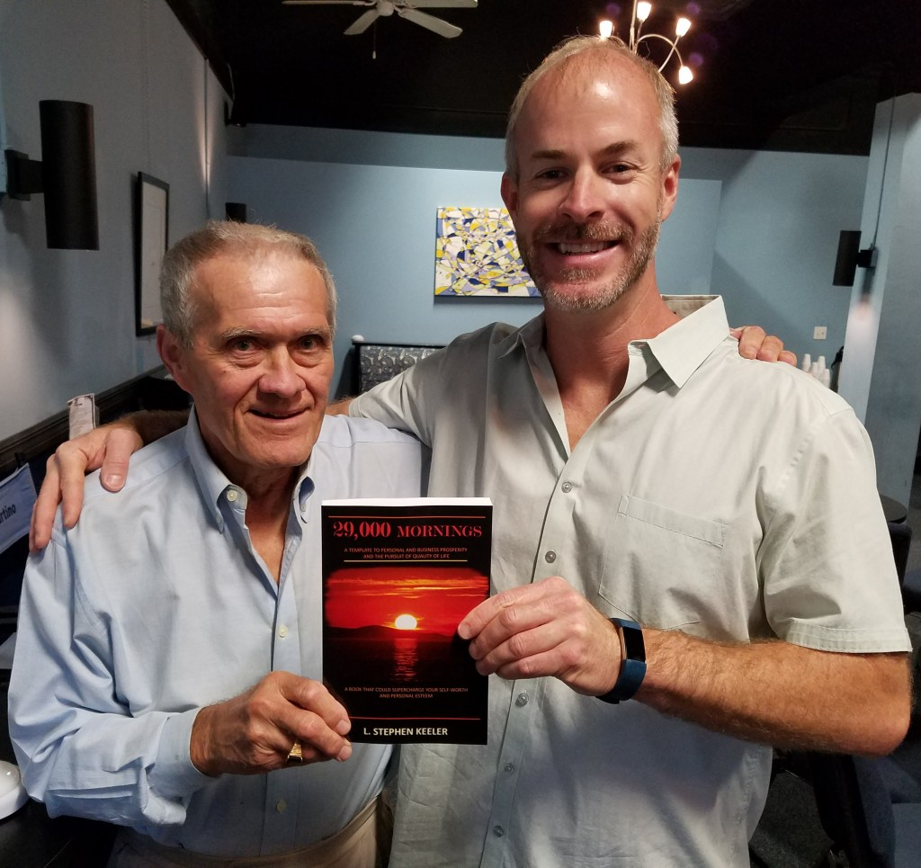 """Steve Keeler and Sean Donovan pose together with Steve's book, """"29,000 Mornings"""""""