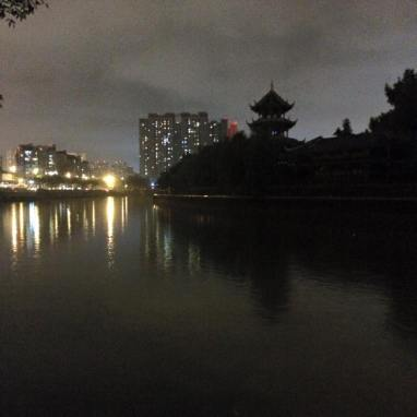 Walking along the river late in the evening in Chengdu.
