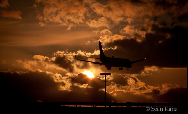 Plane Landing at Sunset