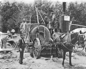Horse pulling street paving equipment on St. Mary's Road, Winnipeg, Manitoba (1912)