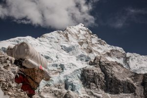 Sherpa leading traveler up Mt. Everest