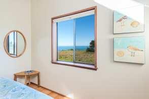 Guest Bedroom 2: Queen bed, views to ocean and meadows