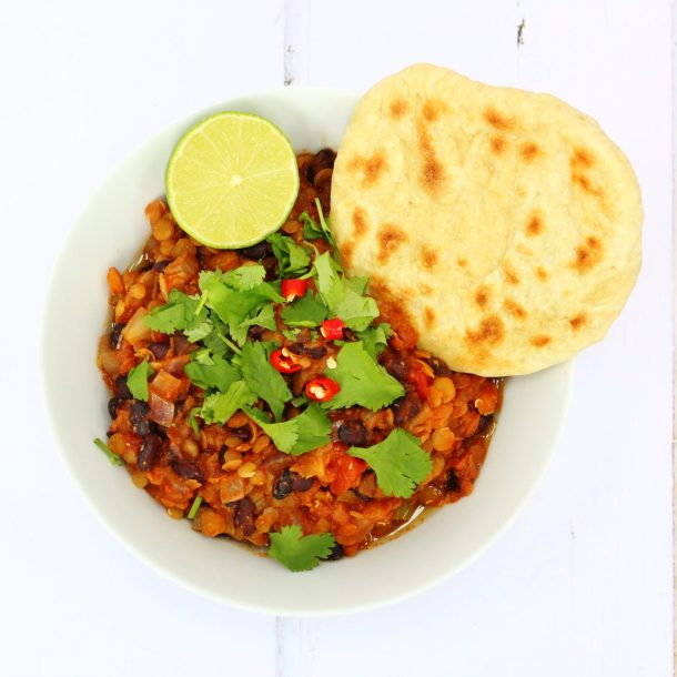 This vegan lentil chilli is a tasty mixture of red and green lentils, black beans, vegetables and spices. It makes a delicious meat-free meal that's perfect for weekends or midweek. It's also a great meal to make in advance and reheat the next day.