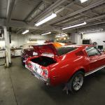 Searles Auto Repair - Lower Workshop Picture Showing Side of Red Dodge Charger