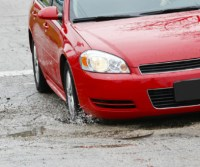 Car in Pothole