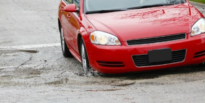 Car in Pothole will wreck your car