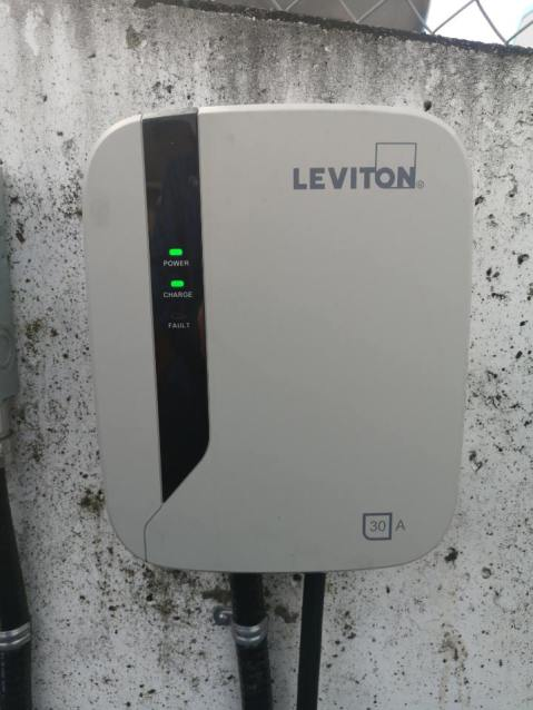 Searles Auto Leviton Electric Vehicle Charging Station Mounted on Wall