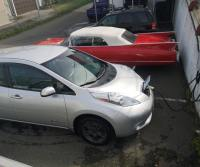 silver nissan leaf plugged into ev charging station at searles auto