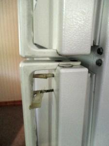 broken door on refrigerator