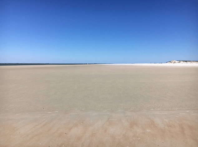 Low tide beach at Ponce Inlet in New Smyrna Beach in Florida