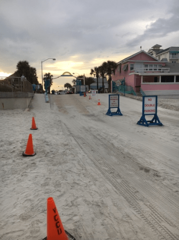 Flagler Ave. beach entrance ramp with view from the beach in the evening sunset