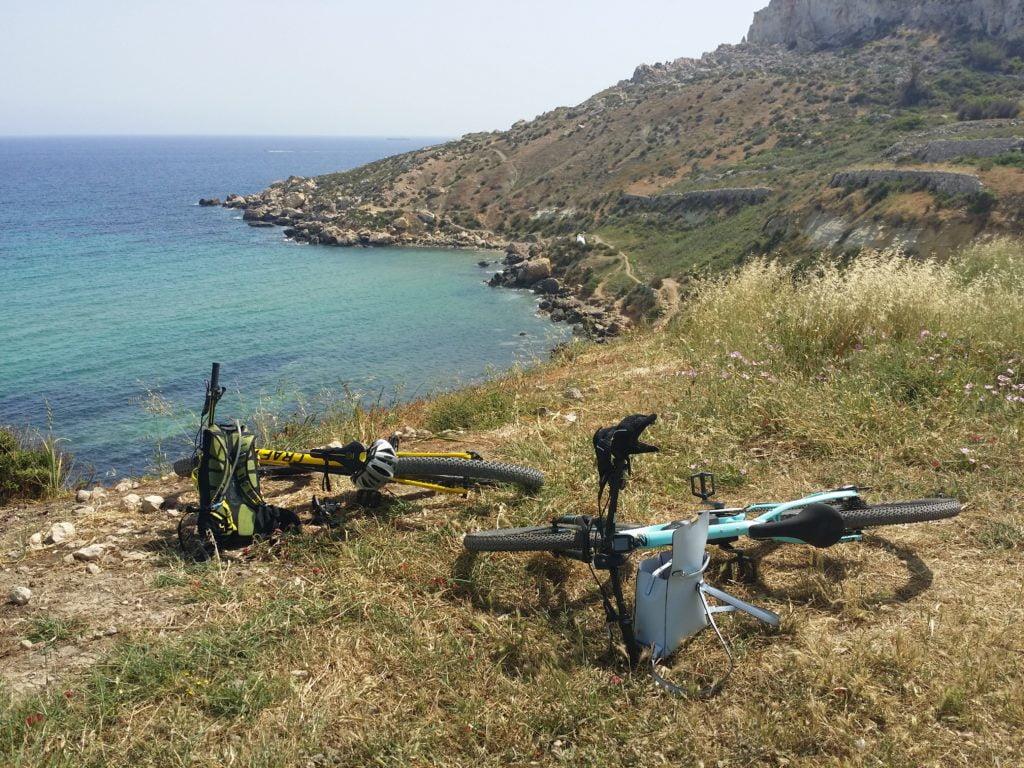 Bikes laying on the ground at Mgiebah bay Malta