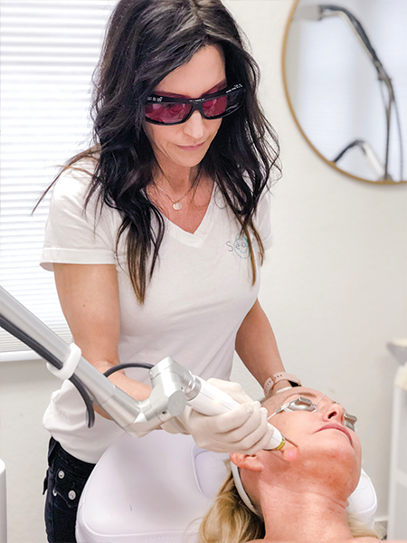 Nurse Kristin performing Laser Services