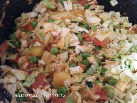 Add cabbage, fresh peas and potatoes to the curry for cabbage fry recipe