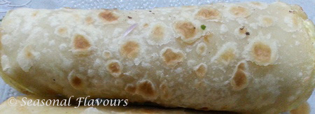Roll up the paratha with stuffing for Kolkata Roll Recipe