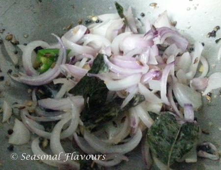 Fry onions for potato filling