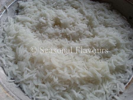 Cook rice till fluffy for Egg fried Rice