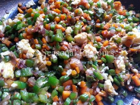 Add egg, seasoning and sauces for Chinese stir fried rice