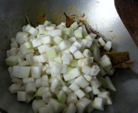 Add diced bottle gourd to chingri mach