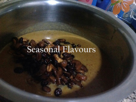 Garnish moong dal payasam with nuts, raisins and coconut slices