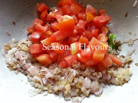 Add chopped tomatoes for black lentils dal recipe